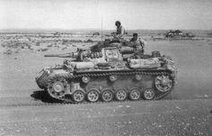 https://flic.kr/p/wSgSyB | Panzerkampfwagen III (5 cm Kw.K. 38 L/42) Ausf. G Tp (Sd.Kfz. 141) Nr. 114 | Un Panzer III (5 cm) du D.A.K. lancé sur une route poussiéreuse d'Afrique du Nord. A l'arrière-plan, on distingue un tracteur d'artillerie lourd semi-chenillé et une pièce antiaérienne de 88 mm.  ________ The Panzer Pictures Database | @PanzerDB (Twitter) | panzerdb.com