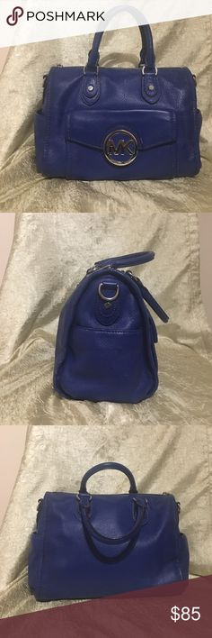 "Micheal Kors satchel Stunning Royal blue with silver hardware. Outside has 3 bickers 1 pocket on each end front has slip pocket with MK logo snap closure. Zippered top closure, double handle. Inside leather bed with Michael Kors signature fabric and has 4 slip pockets and 1 zippered pocket. Protective feet on bottom. No cross body strap( I have misplaced it) in good to Vary good condition!! Small scuffs to leather and hardware outside are the only signs of use. Inside is perfect.10.5""Wx 9""T…"