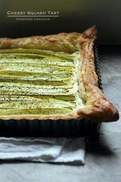 Fresh vegetables and creamy garlic and herb cheese make this squash puff pastry tart a fantastic appetizer choice