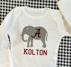 Check out this item in my Etsy shop https://www.etsy.com/listing/220739000/personalized-alabama-elephant-onesie
