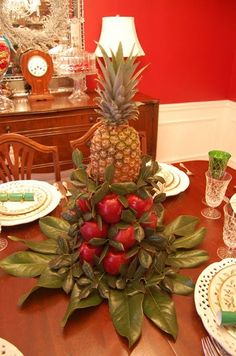 Colonial Williamsburg Christmas Table Setting with Apple Tree Centerpiece - topped with a pineapple