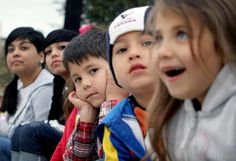 Cousins from left: Mona Castillo, 16; Marissa Castillo, 13; J.J. Rivera, 5; Bubba Stewart, 4; and Mariah Rivera, 7, peer down the parade route as the floats meander toward them on Laurent Street. The family were watching the Victoria Livestock Show parade Saturday morning.