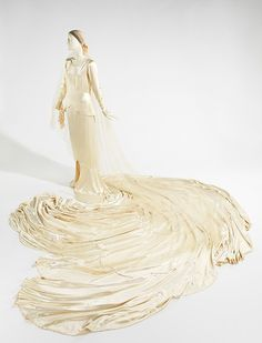 Wedding Ensemble Callot Soeurs 1930 With its cathedral-length train, this dramatic example of a French couture wedding gown illustrates the sleek, reductive look of fashion. Both construction. Vintage Gowns, Vintage Bridal, Vintage Outfits, Vintage Fashion, 1930s Fashion, Vintage Clothing, Couture Wedding Gowns, Bridal Gowns, Wedding Dresses