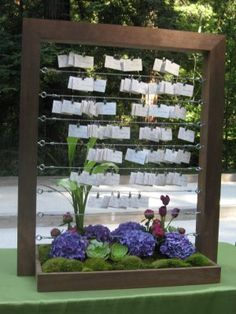 Use picture frames, but with a back. Take out glass and put cork board or burlap, then pin on the escort cards.