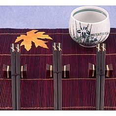 @Overstock - Eat in oriental style with stylish chopsticks  Flatware is medium dark ebony in color with ivory inset accent  All chopsticks and accessories are made from natural woods, therefore color may varyhttp://www.overstock.com/Home-Garden/12-piece-Inlaid-Wood-Chopsticks-Set/4429788/product.html?CID=214117 $26.99