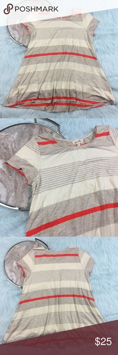 "Puella Anthropologie stripe swing shirt Puella striped short sleeved draped swing shirt from Anthropologie. Womens Size medium, gently used with no flaws. Please see photos for exact details.   Armpit to armpit- 20"" length- 30"" Anthropologie Tops Tunics"