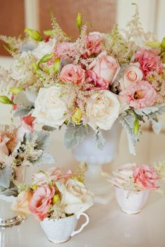 Gorgeous blooms in a milk glass vase and delicate white tea cups. Source: Rachel Mercier Flowers  #milkglass #teacups #centerpiece