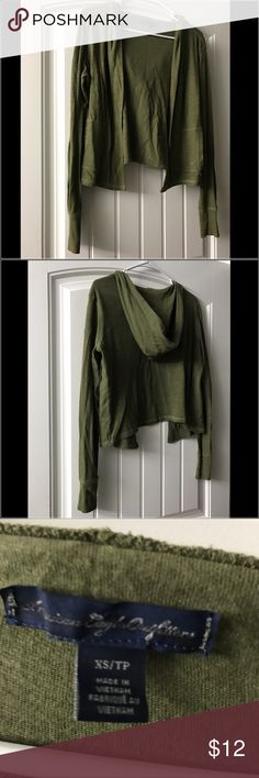 Hooked green cropped cardigan This long sleeve hooded olive green cardigan. Is open front with pockets. Never wore just hung in the closet and looked at. American Eagle Outfitters Sweaters Cardigans