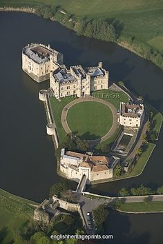 LEEDS CASTLE, Kent. Aerial view. First built in 1119, the castle became a royal palace for Edward I and Eleanor of Castile in 1278, who added the successive gatehouse defences of the barbican. It was later transformed by Henry VIII for Catherine of Aragon. The castle is now managed by the Leeds Castle Foundation.