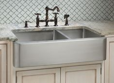 Stainless Steel Apron Sink with Oil Rubbed Bronze faucet.