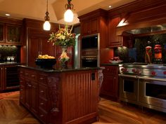 Creative handling of the woods -- from the large floor pattern to the cabinetry -- gives a great sense of space to this small kitchen.