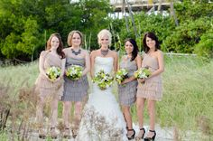 love the mix of neutral bridemaids dresses + bold accessories in this Florida Keys wedding, photo by Brittany Anderson
