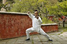 Taoist monk in Tai Chi pose, Tai Shan, Shandong province, China,