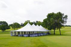 Placed on a golf course, this benefit event was hosted under a pole tent with three open sides and one covered with windowed sidewalls.