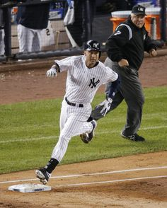 Scripted: Jeter wins it for Yanks in home farewell - New York Yankees' Derek Jeter rounds first base after hitting an RBI double to left field against the Baltimore Orioles in the first inning a baseball game, Thursday, Sept. 25, 2014, in New York. (AP Photo/Bill Kostroun)