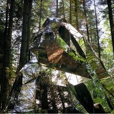 I find that it's very easy to get lost looking into these mirrors, and I really like it. It's like a mysterious or magical rock in the forest in some ways, and I like it.