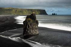 A basalt sea stack on a black sand beach in Iceland [16001068] Photographed by Damien Roué   landscape Nature Photos
