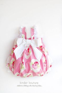 The Lola Pink RoseBaby Bubble is made using an adorable pink cotton fabric. Completely handmade, this gorgeous pinkpolka-dot baby bubble is full of details such as an elasticiized back bodice, a large bow that adorns the front, and flutters along the shoulder seams. The bubble is