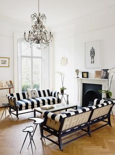 Black and white stripes add a bold touch to this beautiful room.