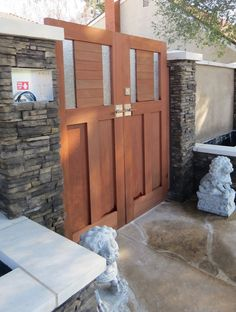 Entry courtyard double gate with contemporary gate latch and deadbolt