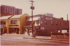"""A view of Wisconsin Avenue near Elm Street.  Today it is where the Regal Cinemas is located -- or very nearby.  You can see """"The Seasons"""" apartment building in the background."""