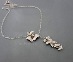 Flower lariat necklace, sterling silver chain, Cascade flowers, by balance9. $24.00, via Etsy.