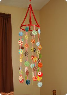 Crib Mobile Tutorial made with fabric scraps.  Would be cute window covering with fabric strips.
