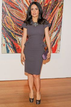 Salma Hayek wore a grey fitted dress with peplum detailing and peep-toe heels.