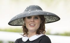 In her monochrome jumper, mid-length floral skirt and matching accessories, Princess Eugenie was the epitome of elegance at the races