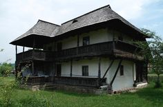 """Traditional houses in rural Romania (case traditionale romanesti) *** Upon arriving in her new home country in the young wife of Prince Carl of Romania noticed in her writings: """"Every R… Romania People, Rural House, Wooden Gates, Vernacular Architecture, Witch House, White Horses, Central Europe, Traditional House, Continents"""