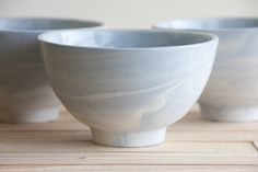Hand made ceramic bowl in marble light blue and white with glossy glaze. modern and urban look