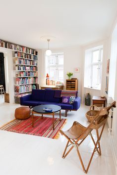 I love the bookshelves and the blue couch