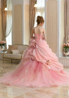 GORGEOUS! I love the roses in the skirt.  In white or cream, it would be an amazing wedding gown!