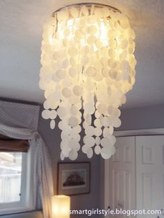 Make a faux capiz shell chandelier for $20!