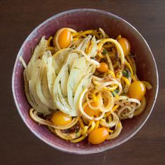 Yellow squash noodles in tomato basil sauce.
