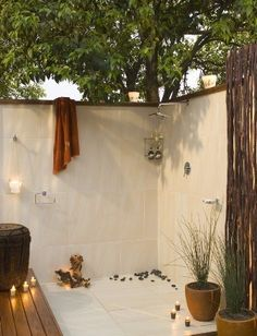 Outdoor shower - with fieldstone or something more rustic instead of the smooth cut stone