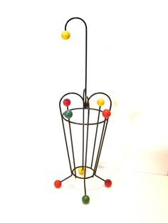 A very cool and unique umbrella stand, circa 1950s made in France iron and color painted decorative wood balls, nice original condition a beautiful piece of art.