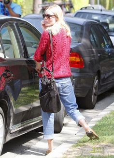Kate Bosworth wearing Cutler & Gross 0734 Keyhole Sunglasses, Isabel Marant Spring 2011 Knitted Pullover in Red, Vanessa Bruno Slouchy Leather Hobo Bag and AG Adriano Goldschmied Boyfriend Crop Jeans.