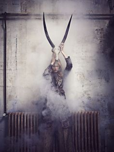Taking the edge of the girly romanticism with the inclusion of 'gothic' natural elements. Love the tonal qualities, and white smoke bomb.