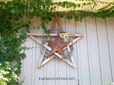25 ways to turn your garden fence into art, crafts, fences, outdoor living, repurposing upcycling, Star on star with grapevine