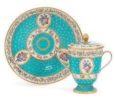 A SÈVRES BLEU-CÉLESTE GROUND CUP WITH COVER AND SAUCER, CIRCA 1793