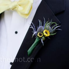 Elliott wore a small and simple boutonniere of mini sunflowers, blue delphiniums and rosemary.