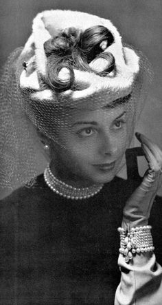 Fabienne Velos wearing hat with voilette by Gilbert Orcel, photo by Pottier, 1948