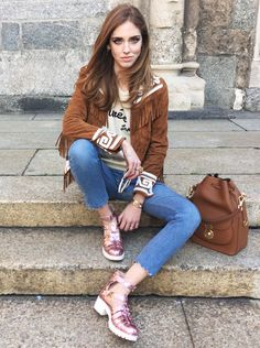 Spring / Summer - street chic style - festival style - boho chic style - brown fringe jacket + denim crop skinnies + pink glitter platform sandals + brown handbag + cream and black chatty t-shirt