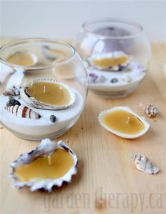 This actually seems pretty simple! Melt candle wax into a good size shell, with a wick in the center, and you're basically done! decorate a jar of your choice with sand (preferably white) and some other shells. Put the shell/candle in the jar. Ta da! A really cute idea.