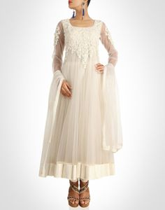 Off-white anarkali exudes an angelic charm, encrusted with pearls.Shop Now: www.kimaya.in