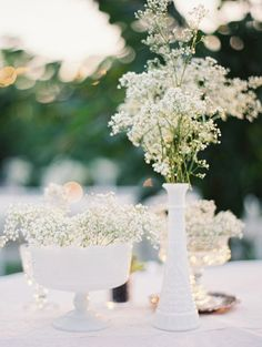 Baby's breath in milk glass wedding centerpiece / http://www.deerpearlflowers.com/rustic-budget-friendly-gypsophila-babys-breath-wedding-ideas/3/