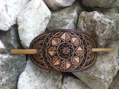 The hair stick is made out of bamboo wood.The hair stick is inch cm).For the protection of the hair stick I used beeswax. The leather carving technic used in these works is unique. Geometric Star, Leather Carving, Hair Sticks, Hair Barrettes, Wedding Ring Bands, Handmade Items, Etsy Handmade, Handmade Gifts, Gifts For Women