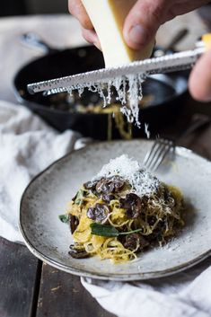 My favorite way to prepare Roasted Spaghetti Squash- sautéd with mushrooms, garlic and sage, dusted with parmesan and pine nuts. Delicious!| www.feastingathome.com