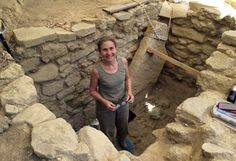 An archaeologist from the University of Cincinnati, Sharon Stocker stands in the shaft tomb of a wealthy, Bronze Age warrior buried alone in about 1500 BC. His intact tomb, discovered by a UC-led international team, contained one of the most magnificent displays of prehistoric riches discovered in mainland Greece in the past 65 years.